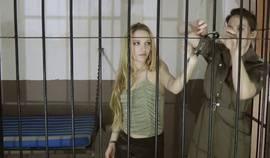 Female Guard Teases Her Prisoner (1)